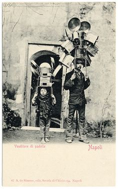 The Kitchenware Sellers (c.1903) by postaletrice, via Flickr (Venditore di padelle [pan sellers]    Vintage photographic postcard, c.1903, uncirculated, undivided back, published by A. de Simone, edit. Stradi di Chiaia 234, Naples, Italy.)