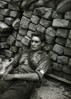 French resistance fighter rests at a barricade. Paris, c. August 1944.