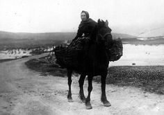 Old photograph of a crofter on a pony carrying Peat back to a cottage on the Isle of Skye, Scotland