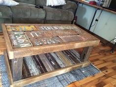 Barnwood coffee table with old license plates under plate glass.