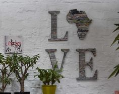 Decor idea for the wall, cool upcycled letters and Africa image made of rolled paper, paired with a I love you photo block and plants to liven up the space.