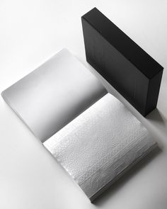 An entirely blind-embossed book—no ink!—for Chanel by Amsterdam-based designer Irma Boom to evoke perfume, which is sensed but not seen.