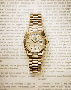 The original 1956 Rolex Day-Date in 18ct yellow gold, the first wristwatch to spell out the day of the week in full in addition to the date.