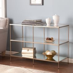 Glamour has never been more functional than with this console table. The metallic gold frame contains the table, making a chic, yet functional statement. Your books, knick-knacks or entertainment ware