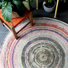 Recycle scrap fabrics and make this attractive eco friendly crochet rug.