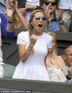 Djokovic's wife Jelena roars him on as the defending champion takes the opening set 7-6 (7-1) on Centre Court