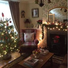 Love love love everything about this...cozy fireplace, wallpapered wall, mirror, tree.  This is the look I want for my living room at Christmas!