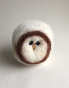 A personal favorite from my Etsy shop https://www.etsy.com/listing/480794524/baby-barn-owl-needle-felting-wool