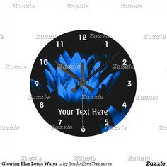 Glowing Blue Lotus Water Lily Flower Art Round Clock.  From Smilin' Eyes Treasures at Zazzle.
