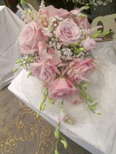Cascade bouquet of roses, orchids, astilbe and gypsophila
