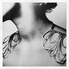 Silver looped shoulder piece, contemporary jewellery design // Sigurd Persson www.thesterlingsi... Women's Jewelry - http://amzn.to/2knipJV