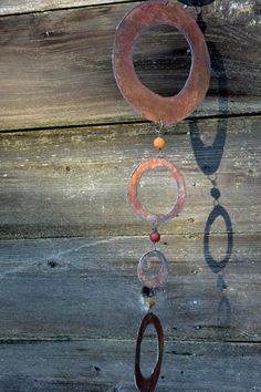 These are really fun - introducing - House Beads! Hand cut salvaged steel circles paired with African Recycled Glass Beads strung together with wire.