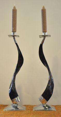 These candlesticks are the perfect mix between a modern design and rustic materials. Made out of Alpaca horns, the curvy design is a statement piece for any dining room table. Shop at disenobos.com