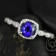 This engagement ring is designed for those who love simple with a slight twist. The round cut in the center is traditional while the cushion halo gives it a little twist!  All stones used are only premium cut, fairly traded, and/or conflict-free! Our diamonds are always natural NEVER treated or enhanced for better color or clarity. Our products are only created with the finest of recycled metals. Rosados Box(TM) works hard to save the world one piece of jewelry at a time! :)   To see the...