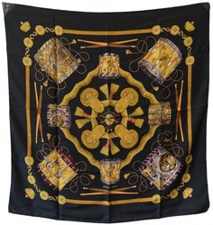 """Hermes, Silk """"Les Tambours"""" Scarf In Black : Lot 66. Authentic Hermes silk les tambours scarf in excellent condition. Original silk screen design by Joachim Metz features a selection of colorful drums over a black silk background. 100% silk, hand rolled hem, made in france. Excellent condition. NO stains, smells, or fabric pulls. Perfect for music lovers and hermes scarf collectors. Measurements: 35''x35'' = 90cm."""