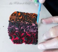 Sutton Slice is a polymer clay technique developed by Pete Sutton. Insructions: little pieces of raw polymer clay are pushed into the recesses of a rubber stamp, until all the recessed areas are filled to the rim with clay. A sheet of clay in contrasting color is pressed onto the stamp to adhere to the clay pressed into the stamp recesses, and then the stamp is gently peeled away from the clay sheet. Written info found here: http://www.polymertutorials.com/polymer-clay/sutton-slice.html