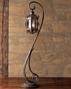 I love this antique street light look for inside. Gothic Floor Lantern by John-Richard Collection at Horchow.