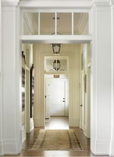 Love the transom over the doorway. melanie davis designed hallway