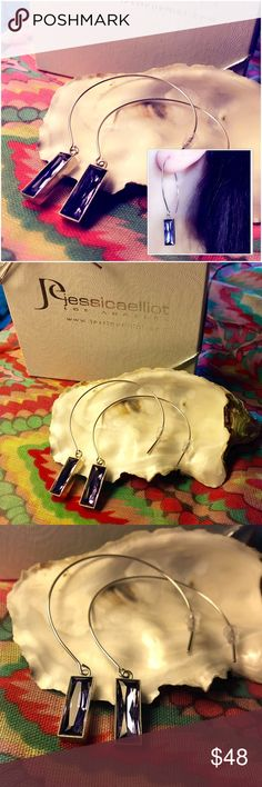 Swarovski Tanzanite Crystal 💜 Open-Hoop Earrings MADE in the USA! Hand-fabricated open hoop earrings by Jessica Elliott. Genuine Swarovski Tanzanite baguette crystals set in Rhodium-Plated Alloy Metal - Nickle free. Beautifully boxed and ready for gift-giving. The tanzanite crystals are a royal purple color and faceted to give that sparkle you expect from Swarovski crystals. OFFERS WELCOME! Jessica Elliot Jewelry Earrings