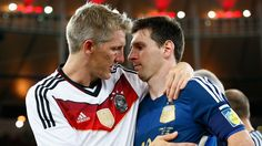 RIO DE JANEIRO, BRAZIL - JULY 13: Bastian Schweinsteiger of Germany hugs Lionel Messi of Argentina after Germany's 1-0 victory in extra time during the 2014 FIFA World Cup Brazil Final match between Germany and Argentina at Maracana on July 13, 2014 in Rio de Janeiro, Brazil. (Photo by Martin Rose/Getty Images)