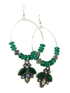 The #HoopEarrings are made with green oval faceted #GlassBeads and silver plated lentils.  They are lightweight and hang about 2 1/2 inches.  Only #2Available #taraelisabethdesigns #Handmade #HandmadeJewelry #Jewelry #FashionJewelry #LimitedQuantity