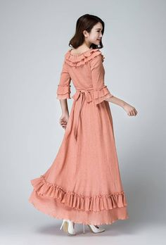 make an entrace in this gorgeous , dust pink linen maxi festival dress . Featuring ruffle ditail at the necklinen, Botton hem, and sleeve, And the back tie belt waist for an ethereal look . wear it for an outdoor soiree and spring weeding . DETAILS: * Soft linen * bateau neck linen *