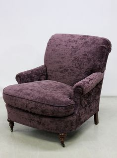 Upholstered Purple Velour Contemporary Armchair on Mahogany Legs. Pre-Sale Estimate $200-$250