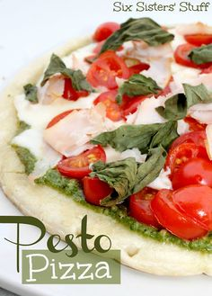 Fresh Pesto Pizza from sixsistersstuff.com. Your mouth will be watering while this is cooking! #pizza #pesto #recipe