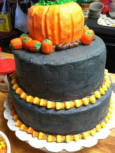 Pumpkin bundt cake, candy corn border, Mickey Mouse silhouette inlay.