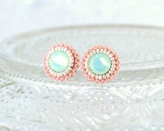 Teal and coral stud earrings.