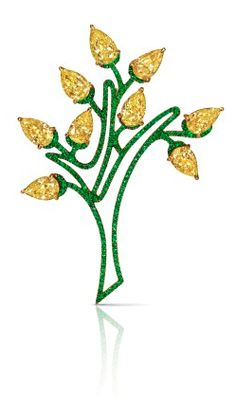 A hollow tree brooch sprouting yellow diamond leaves featuring 9 cape-colored, pear-shaped diamonds weighing a total of 10.09 carats, with pavé set tsavorite detail. Mounted in platinum and 22k yellow gold.