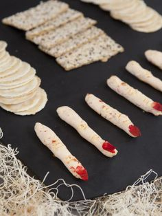 Halloween party guests of all ages will enjoy these creamy fingers topped with a sliced almond fingernail.