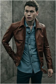 Beckham for Belstaff Pre-Fall 2015. Good looking man in blue shirt and brown leather jacket