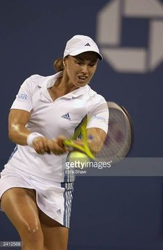 Martina Hingis of Switzerland returns a shot to Amanda Coetzer of South Africa during the US Open at the USTA National Tennis Center on August 31...