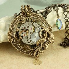 Steampunk Necklace Steampunk Pendant Steampunk Pocketwatch Necklace Brass Filigree Steampunk Gold Gears Necklace Silver Vintage Watch. $65,00, via Etsy.