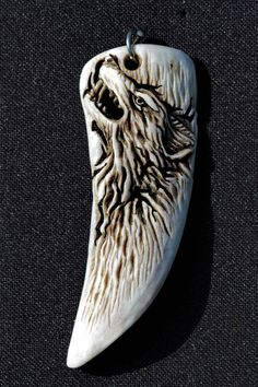 the symbol of the Wolf made from Deer antler 1 by manuroartis on DeviantArt Deer Antler Jewelry, Deer Antler Crafts, Antler Art, Deer Antlers, Deer Antler Ring, Quetzalcoatl Tattoo, Bullet Casing Jewelry, Whittling Wood, Bone Crafts