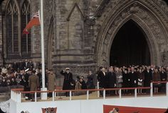 Ottawa, ON Feb 15, 1965 Old Canadian Flag being lowered for last time on Parliament Hill - landscape version. Source - LAC
