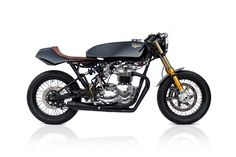 Some motorcycles belong out in the garage. Others are special enough to bring in the house. Michael Woolaway's latest artistic creation, a classy 1978 Triumph T140, will be getting the royal treatment as a centerpiece inside... More