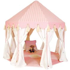 The Rose Pink Pavilion Play Tent is a luxury for any child that is expertly stitched of the finest embroidered woven cotton and comes with the matching floor quilt to make it even cozier inside. From the striped roof complete with tassels, to the detachable curtains and matching appliqued floor, no detail has been spared. A great addition to the garden, playroom, or bedroom. The perfect spot to hold her tea parties and imagine the afternoon away. This item is custom made and comes fro