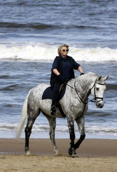 Queen Beatrix..... wow she is not holding the reins right at all.. kinda awkward