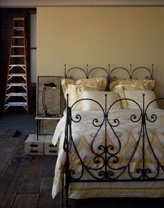 Very similar to my current bedroom colors. Wrought iron bed, yellow, cream