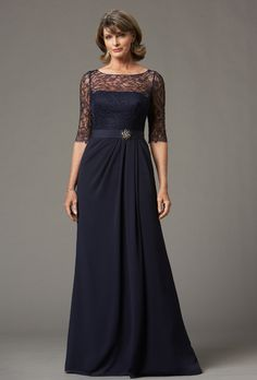 Collection 20. Navy crinkle chiffon and lace bateau lace illusion neckline with a draped bodice and three quarter length sleeves. Side draped A-line floor length skirt with a set in grosgrain sash.