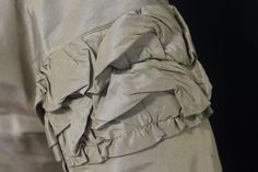 """sleeve detail - Elegant Post Civil War Changeable Silk Dress C 1860's 1870'S   eBay seller ariava100; bodice mix of hand and machine sewing, lined in white & brown polished cottons, 8 cram silk/net buttons close center front; silk lace, bow in back; skirt almost all hand sewn, 15"""" of polished cotton lining at hem; bust: 30""""; waist: 24""""; front length: 53""""; back length: 69""""; hem circumference: 176"""""""