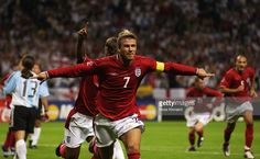 David Beckham Captain of England celebrates scoring during the Group F against Argentina at the World Cup Group Stage played at the Sapporo Dome, Sapporo, Japan on June 7, 2002. England won the match 1-0.