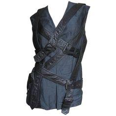 Preowned Vintage Wrap Straps Bondage Vest ($775) ❤ liked on Polyvore featuring outerwear, vests, multiple, vintage waistcoat, vest waistcoat, blue waistcoat, vintage vest and blue vest