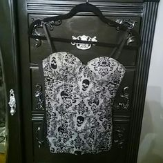 Corsett Black and white skull corsett.  Worn once.  Super cute with ripped jeans! Tops Camisoles