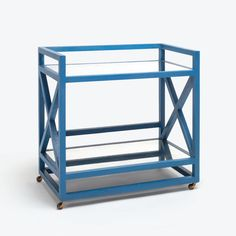 Raffia and Antiqued Mirror X Bar Cart Faux Raffia Finish with Two Antiqued Mirror Shelves Available Finishes: Faux Raffia in French Blue, Black orOff-White