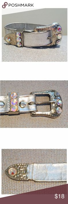 "80s Bracelet Metallic Leather Rhinestone Buckle True vintage/retro mid 80s silver metallic genuine leather wristband belt buckle bracelet w/ iridescent rhinestones. Fits up to 7"" wrist. Used vintage condition: creasing in leather, 2nd hole slightly larger due to wear, & slight wear to metallic finish around the 1st hole (see last pic). Wish I could capture in pics the bright silver finish & sparkle of the faceted rhinestones. Any conditions noted do not detract from this fun glitzy eye…"
