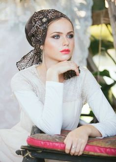 Brown head covering made of crepe and chiffon, featuring a fan of material decorated with a stone. Just place this head covering on your head and tie! A  Sinar  style head covering is made of an apron-shaped piece of material (a large rectangle with t