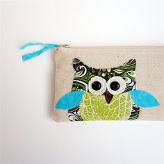 Lovely, quirky owl purse by Laura Clauson on Etsy. Really like the colours and mix of fabrics on the design.